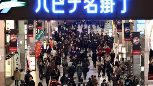 People walk through a shopping street in Sendai, Miyagi Prefecture, Japan.