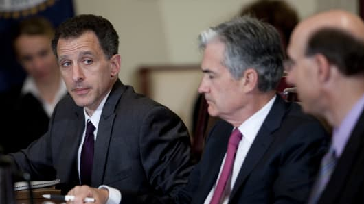 U.S. Federal Reserve Governors Jeremy Stein, left, and Jerome Powell, listen during an open meeting of the Federal Reserve Board in Washington, D.C.