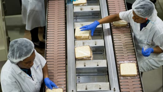 Employees arrange wrapped Passover matzo to go into cartons at the Manischewitz Co. factory in Newark, New Jersey.