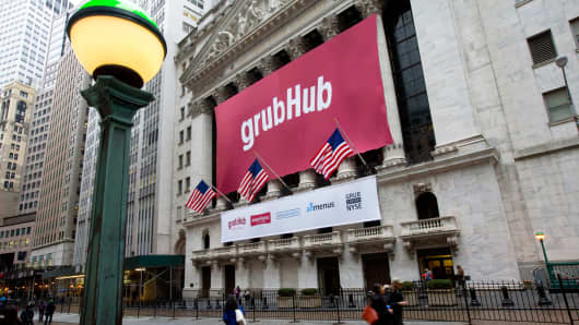 A GrubHub banner on the exterior of the New York Stock Exchange on Friday, April 4, 2014.