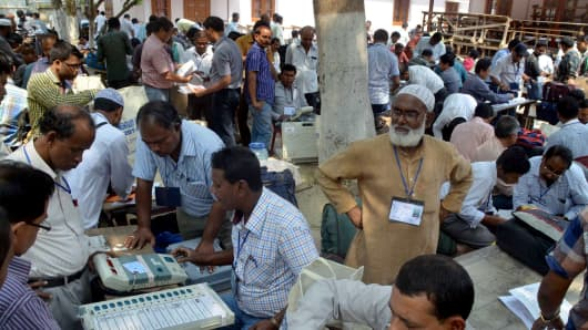 Indian poll officials check Electronic Voting Machines (EVM) at a distribution centre in Nagaon, some 180 kms east of Guwahati on April 6, 2014.