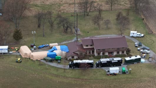 In this aerial photo taken from WTHR Chopper 13, FBI agents work around the home of 91-year-old Donald Miller in Waldron, Ind. on Wednesday, April 2, 2014.