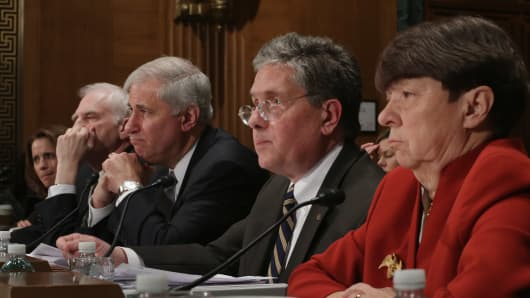 (L-R) Treasury Undersecretary for Domestic Finance Mary Miller, Federal Reserve System Governor Daniel Tarullo, Federal Deposit Insurance Corporation Chairman Martin Gruenberg, Comptroller of the Currency Tom Curry and Securities and Exchange Commission Chairwoman Mary Jo White testify before the Senate Banking, Housing and Urban Affairs Committee in the Dirksen Senate Office Building on Capitol Hill February 6, 2014 in Washington, DC.