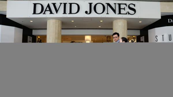 Pedestrians walk past a David Jones Ltd. department store in the central business district of Melbourne, Australia.