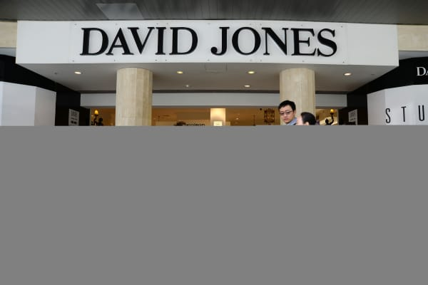 Pedestrians walk past a David Jones Ltd. department store in the central business district of Melbourne, Australia.