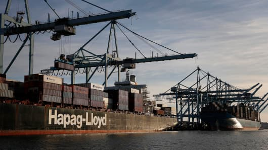 A Hapag-Lloyd AG container ship is unloaded at the Port of Los Angeles in San Pedro, California.