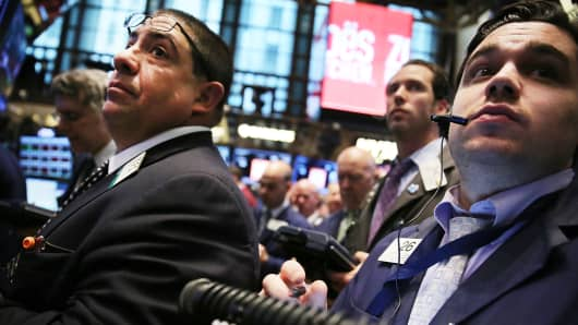 Traders on the floor of the New York Stock Exchange, April 11, 2014.