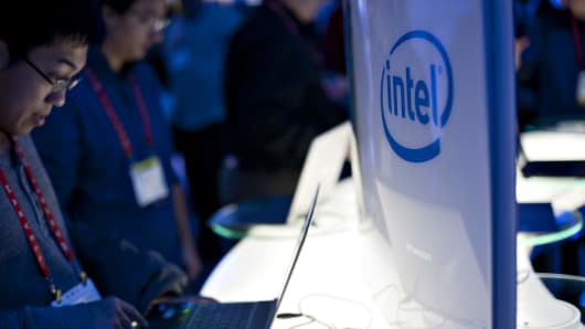 Attendees at the Consumer Electronics Show in Las Vegas look over Ultrabook computers at the Intel Corp.