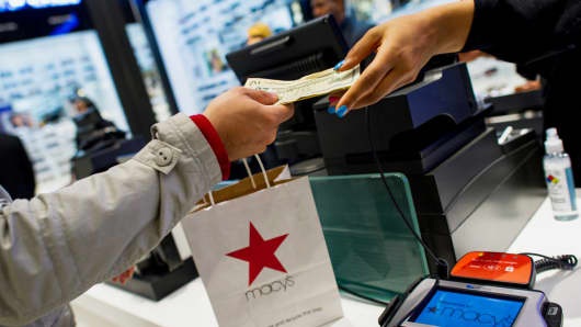 An employee rings up a customer at the Macy's flagship store in New York.