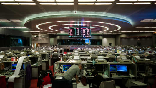 A trader is seen at the stock exchange in Hong Kong.