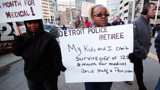 People, mostly union and retired city workers, protest in front of the U.S. Courthouse, October 23, 2013, Detroit, Michigan.