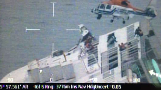 In this handout image provided by the Republic of Korea Coast Guard, rescue work by members of the Republic of Korea Coast Guard continues around the ferry sinking off the coast of Jindo Island on April 16, 2014 in Jindo-gun, South Korea.