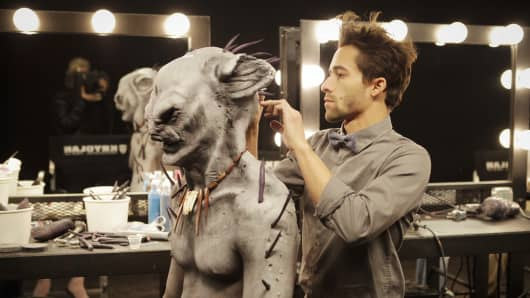 A contestant on Syfy's show Face Off working on one of his creations.