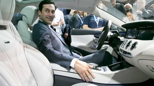 Actor Jon Hamm sits in the 2015 Mercedes Benz S63 AMG Coupe, during its introduction at the 2014 New York International Auto Show, Wednesday, April 16, 2014, in New York.