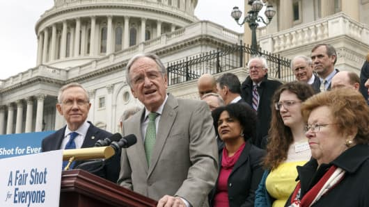 Sen. Tom Harkin, D-Iowa, chairman of the Committee on Health, Education, Labor and Pensions, center, joins fellow Senate Democrats to urge approval for raising the minimum wage, during a news conference at the Capitol in Washington, April 2, 2014.