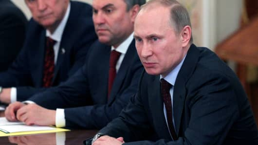 Russian President Vladimir Putin attends a meeting with members of the Council of the Federafion in Moscow, Russia.