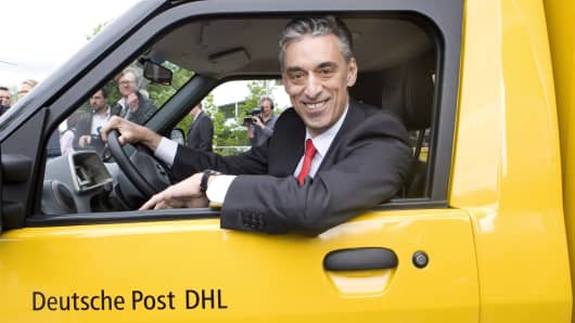 Frank Appel, CEO of Deutsche Post DHL, in one of his company's carbon-neutral mail delivery vehicles