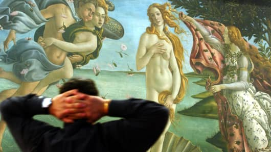 A viewer admires the 'Birth of Venus' by Sandro Botticelli, at the Uffizi Gallery in Florence.
