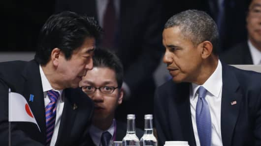 Japan's Prime Minister Shinzo Abe and President Barack Obama attend the opening session of the at the 2014 Nuclear Security Summit on March 24, 2014 in The Hague, Netherlands.
