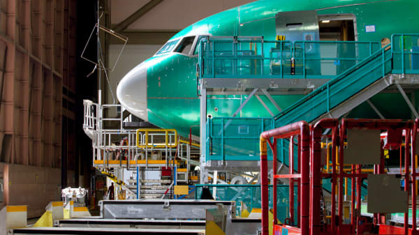 A nearly completed Boeing 777 reaches the end of a production line at the company's facility in Everett, Washington.