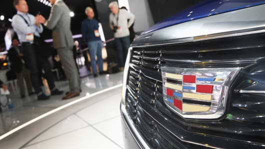 Cadillac's emblem is displayed on the front of a Cadillac ATS Coupe in Detroit.