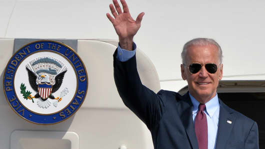 Vice President Joe Biden waves after landing at the Boryspil airport in Kiev on April 21, 21014. US Vice President Joe Biden arrive for a two-day visit to Ukraine, hours after a fragile Easter truce was shattered and pro-Kremlin rebels in the country's east appealed for help from Russian 'peacekeepers'.