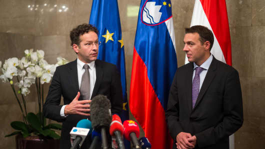 Slovenian Finance Minister Uros Cufer and Dutch Finance Minister and Eurozone President Jeroen Dijsselbloem