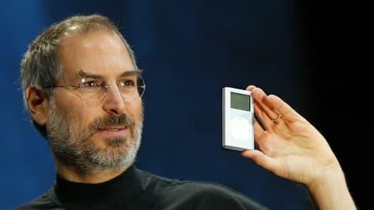 Apple CEO Steve Jobs holds a new mini iPod at Macworld on January 6, 2004, in San Francisco.
