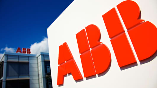 Logos of ABB AG sit on display outside the company's semi-conductor plant in Lenzburg, Switzerland.
