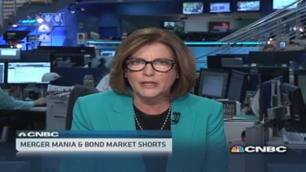 Merger mania sweeps Wall Street