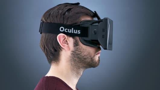A man wearing a development stage Oculus Rift virtual reality mask.