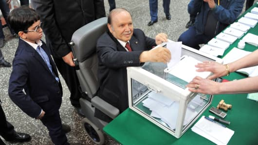 Algerian President Abdelaziz Bouteflika casts his vote in the country's recent presidential elections in el-Biar suburb of Algiers on April 17, 2014.