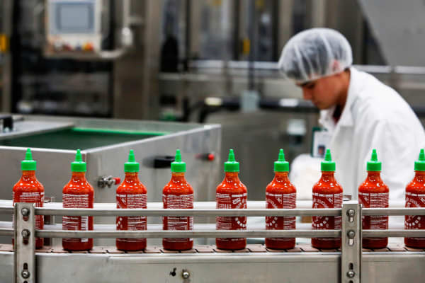 Bottles of the Sriracha hot sauce travel down a conveyor belt at the Huy Fong Foods Inc. facility in Irwindale, California.