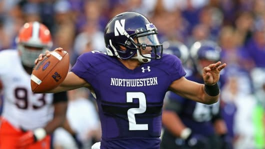 Kain Colter, No. 2 of the Northwestern Wildcats, passes against the Syracuse Orange in September 2013 in Evanston, Ill.