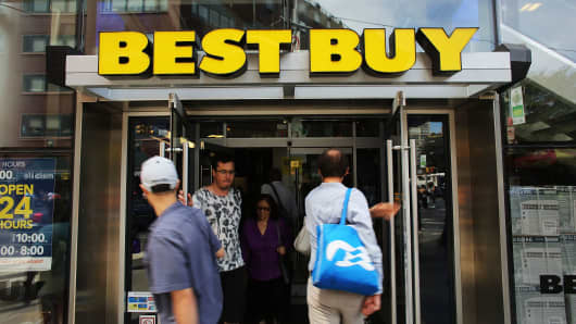 People walk into a Best Buy store in New York City.