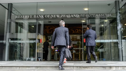 People enter the Reserve Bank of New Zealand (RBNZ) headquarters in Wellington, New Zealand.