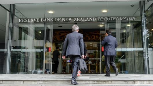 People enter the Reserve Bank of New Zealand (RBNZ) headquarters in Wellington, New Zealand.