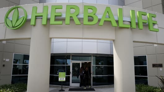 People enter the Herbalife Ltd. Los Angeles distribution center in Carson, California, U.S.