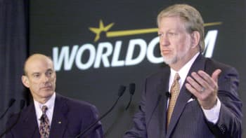 Bernard J. Ebbers, right, president and CEO of MCI WorldCom Inc., speaks as William T. Esrey, chairman and CEO of Sprint Corp., listens during a news conference in New York, October 5, 1999.