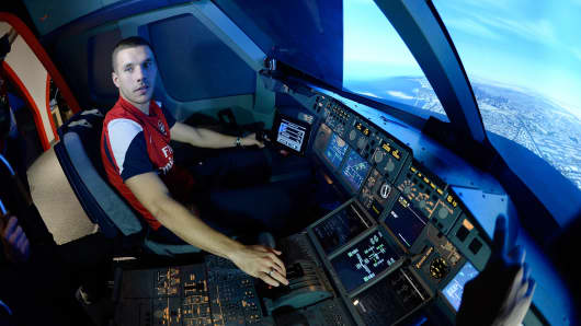 Lukas Podolski of Arsenal in the Emirates' A380 flight simulator on October 31, 2013 in Greenwich, England.