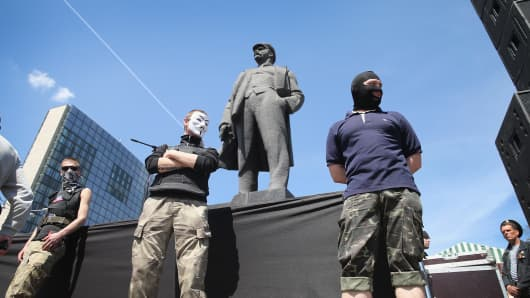 Pro-Russian activists guard speakers in front of the stage during a rally held by pro-Russian activists in Lenin Square.
