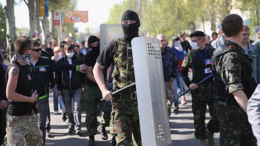 Pro-Russian activists prepare to break through the gate in front of TRK Donbass television station on April 27, 2014 in Donetsk, Ukraine.