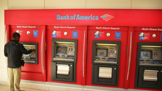 A man uses an ATM at a Bank of America branch on April 16, 2014 in New York City.