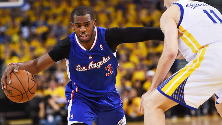 Chris Paul #3 of the Los Angeles Clippers drives on Klay Thompson #11 of the Golden State Warriors in Game Four of the Western Conference Quarterfinals during the 2014 NBA Playoffs at ORACLE Arena on April 27, 2014 in Oakland.
