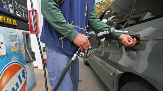 Man pumps gas in Weymouth, Mass.
