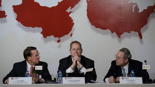 (L to R) Executive director and president of Smithfield, Larry Pope, Smithfield chief financial officer, Kenneth Sullivan and Smithfield executive vice president Robert Manly attend a press conference in Hong Kong.