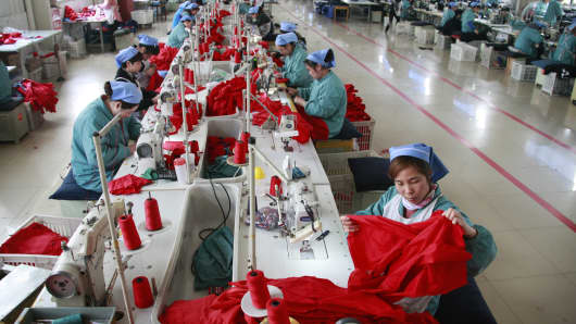 Seamstresses work at a clothing company in Huaibei, China.