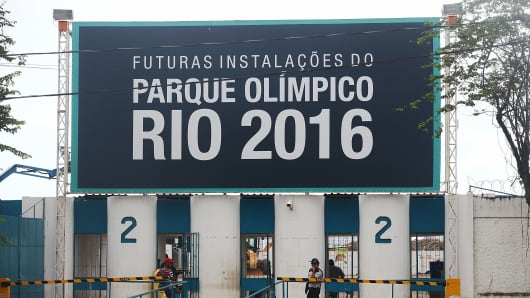 A security guard keeps watch at the entrance to Olympic Park, the primary set of venues being built for the Rio 2016 Olympic Games.