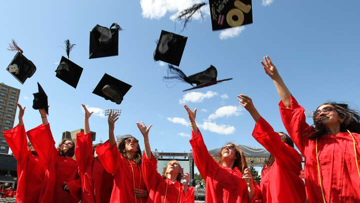 Graduates toss their caps at Boston University.