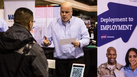 A recruiter for Compass Group, speaks with a veteran at a 'Hiring our Heroes' Job Fair on March 27, 2014 in New York City.